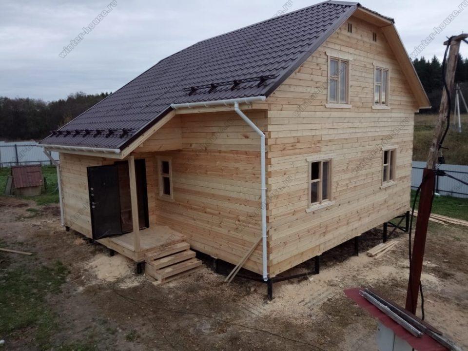Фото двухэтажного дома из бруса с террасой