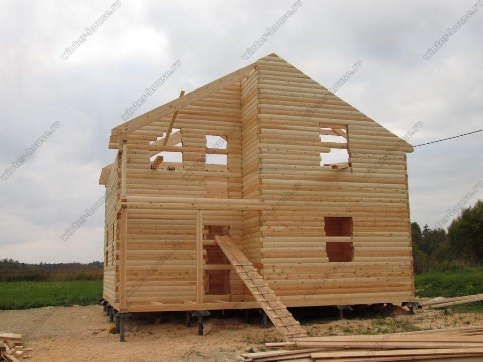 Проект дома 8 на 8 из бруса с верандой фото1