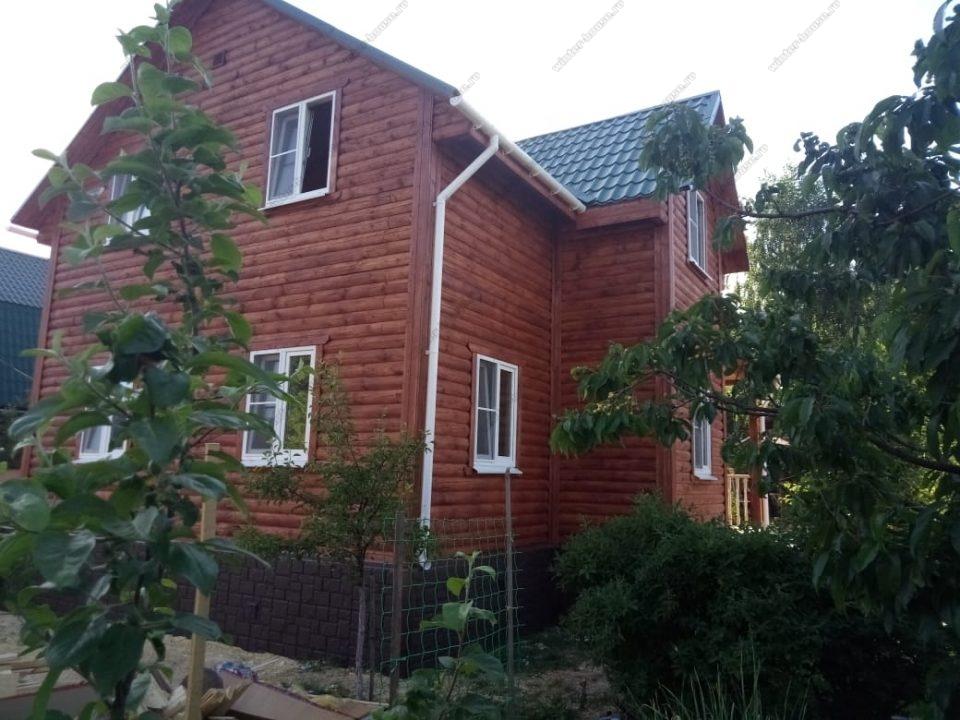 Фото дома из бруса с эркером