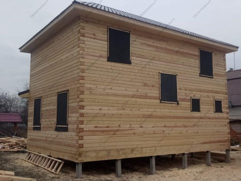 Фото двухэтажного дома из бруса без отделки