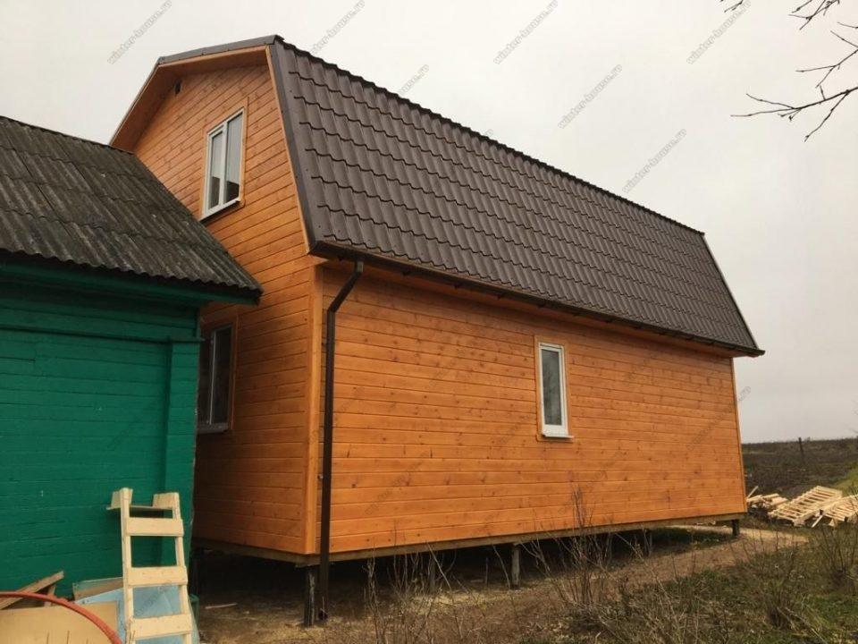 Фото и планировка двухэтажного дома с отделкой