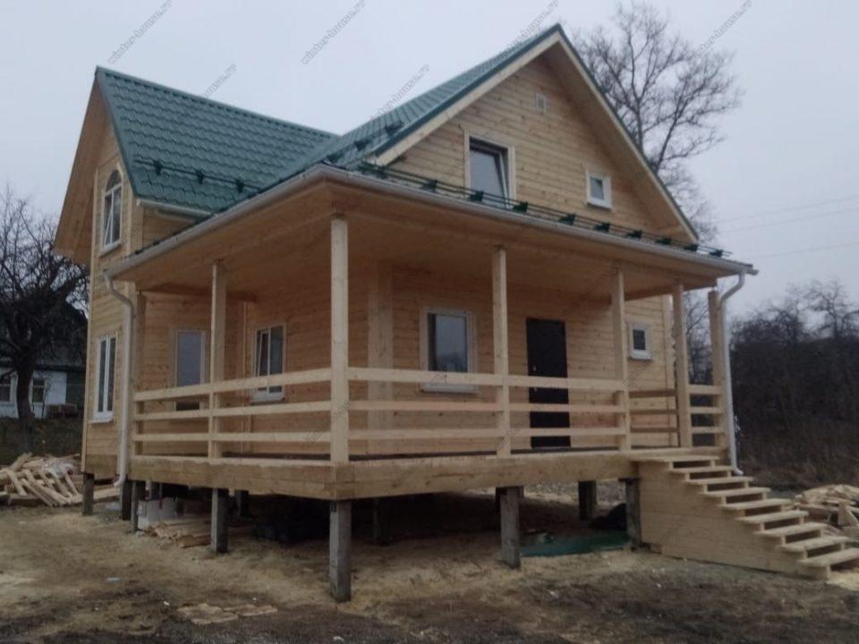Строительство дом из бруса 8 на 8 с террасой и эркером фото и цена