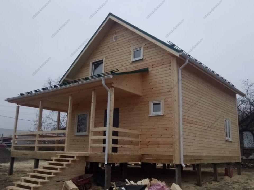 Фото построенного двухэтажного деревянного коттеджа цена под ключ
