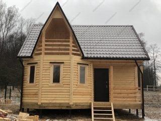 Дом из бруса 7х7 с эркером и балконом
