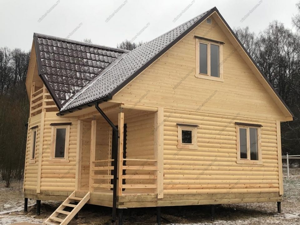 Фото построенного брусового дома 7х7 с мансардой