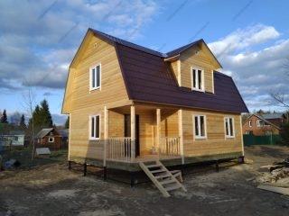 Фото строительства дома из бруса 6х9 с мансардой и террасой