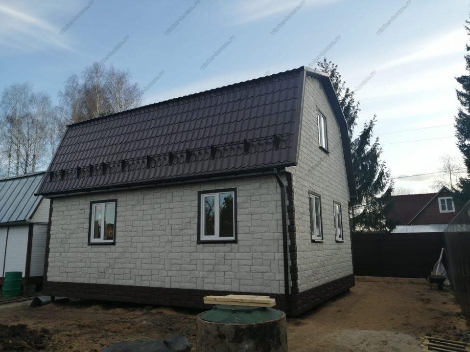 Каркасный дом внешняя отделка фасада панелями под камень