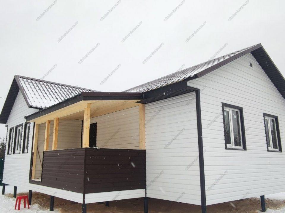 Фото строительства каркасного дома с сайдингом и металлочерепицей
